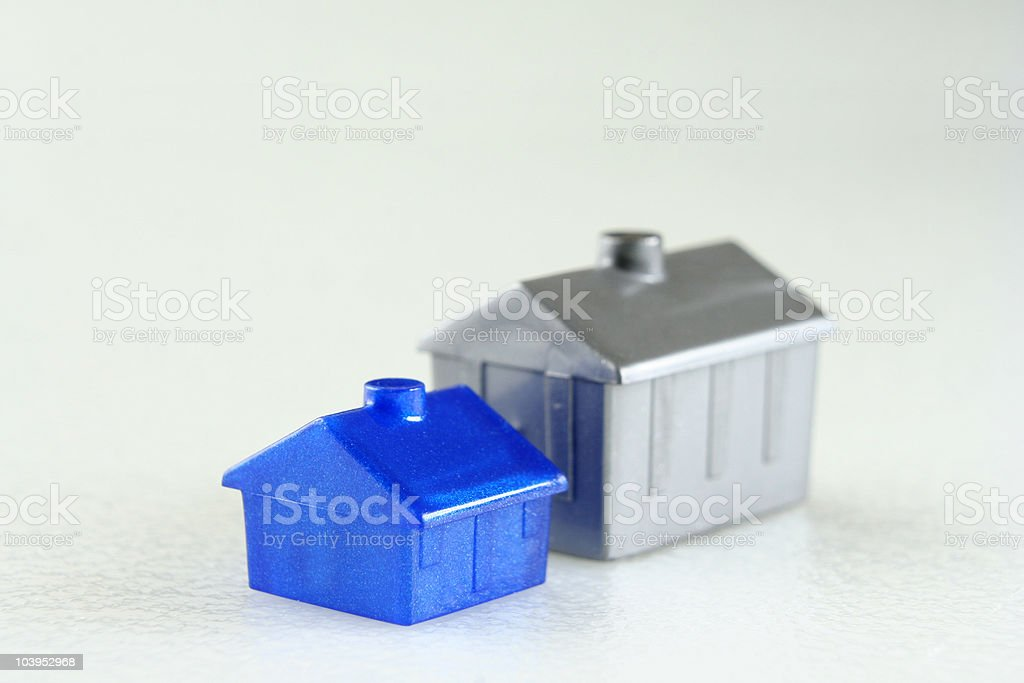Blue plastic house and silver hotel royalty-free stock photo