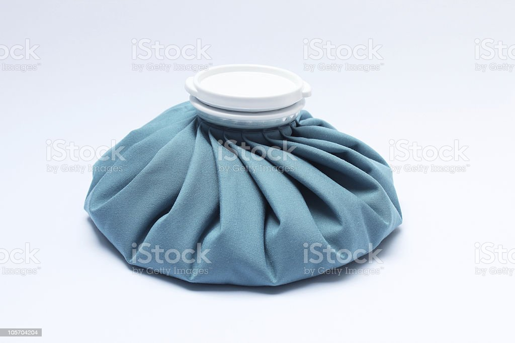 Blue plastic refillable ice pack with a white stopper stock photo