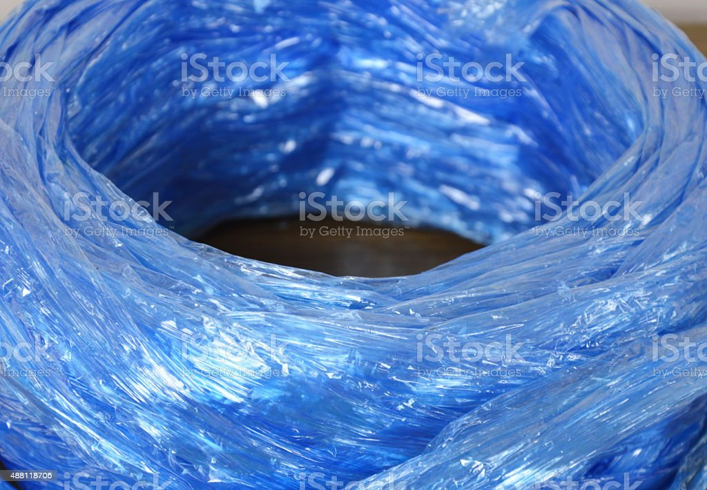 blue plastic rope roll on table stock photo