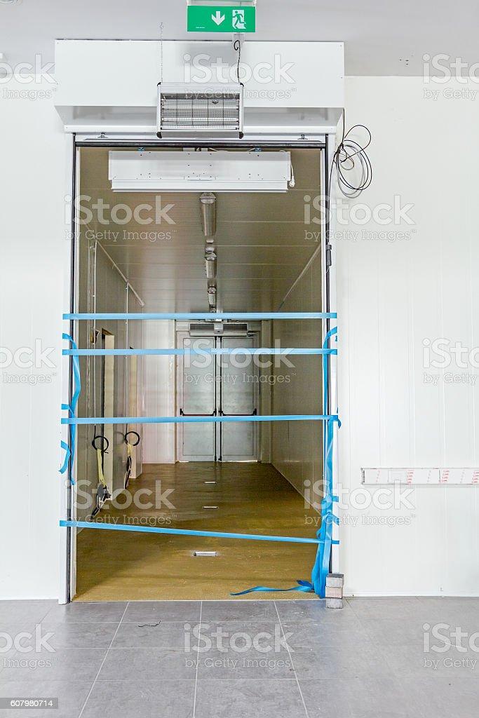 Blue plastic tape on doorway stock photo