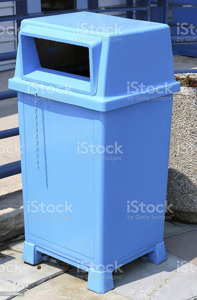 Blue Plastic Trashcan royalty-free stock photo