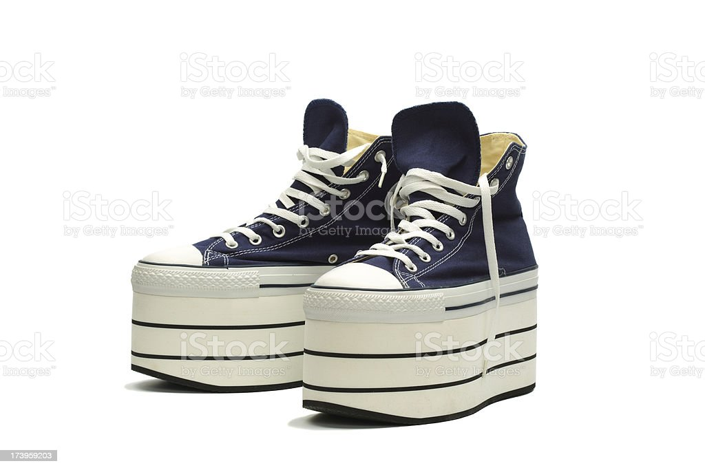 Blue platform sneakers with white laces stock photo