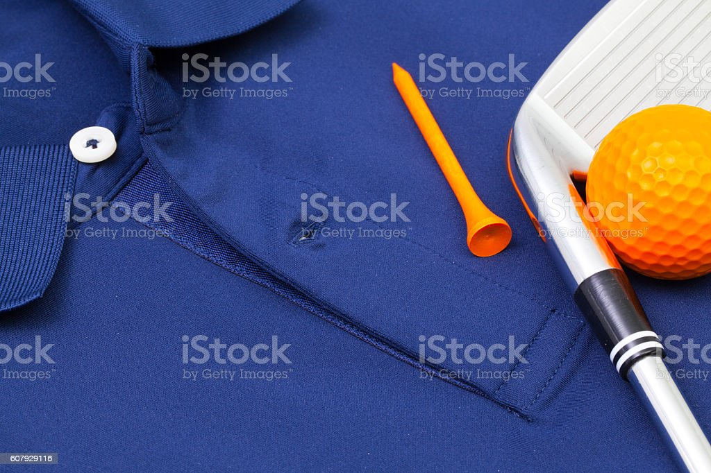 Blue polo shirt and golf equipments stock photo