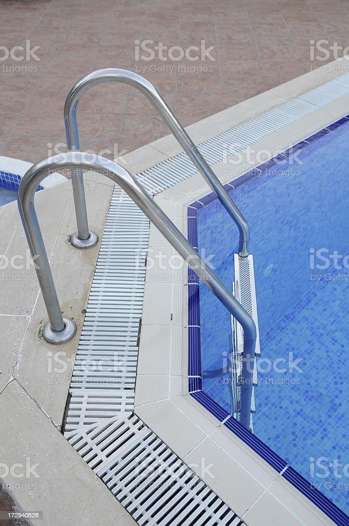 Blue pool ladder royalty-free stock photo