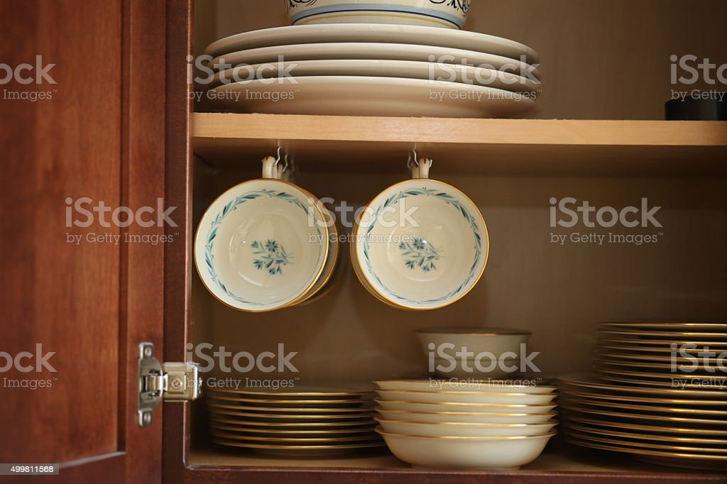 blue porcelain china in cabinet stock photo