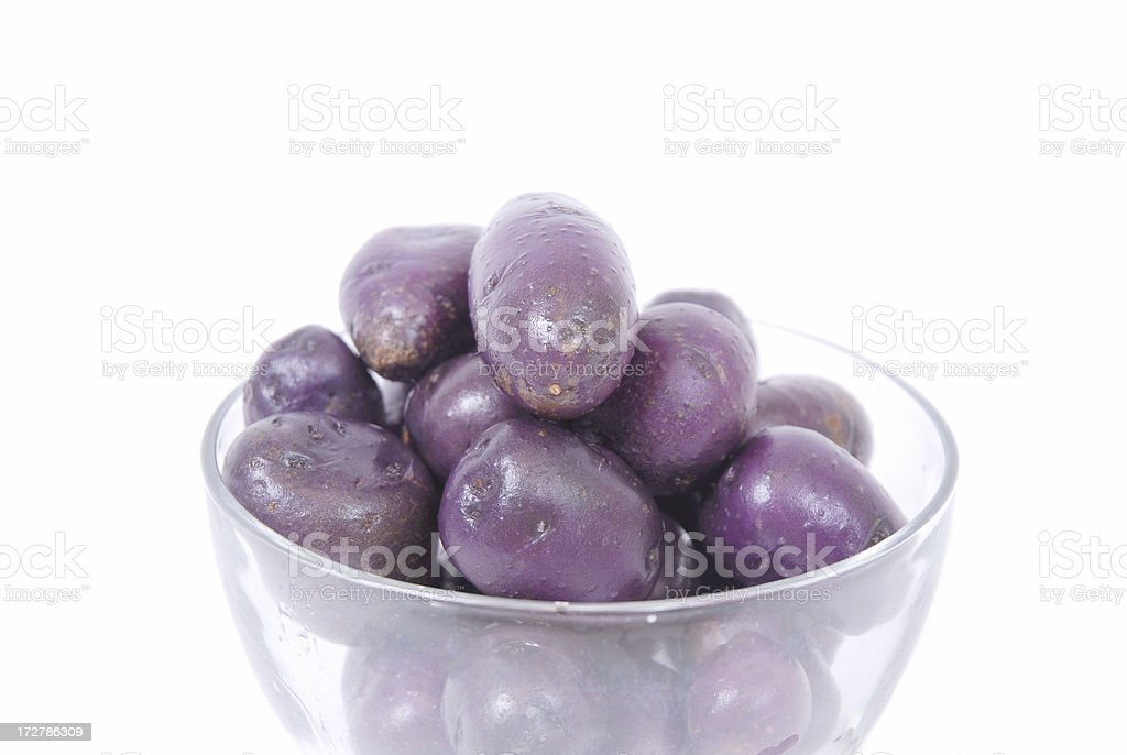 Blue Potatoes in Bowl - cleaned and wet stock photo