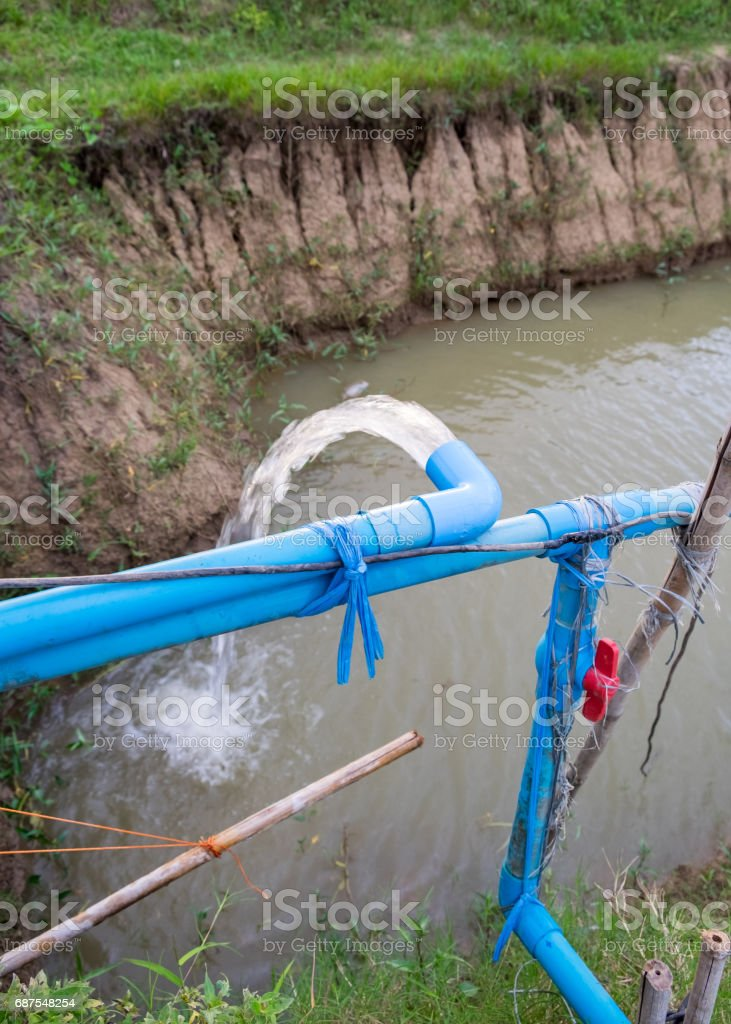 Blue pump pipe water flow down stock photo