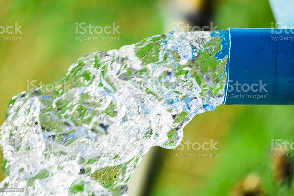 Blue pump pipe water flow equipment agriculture stock photo