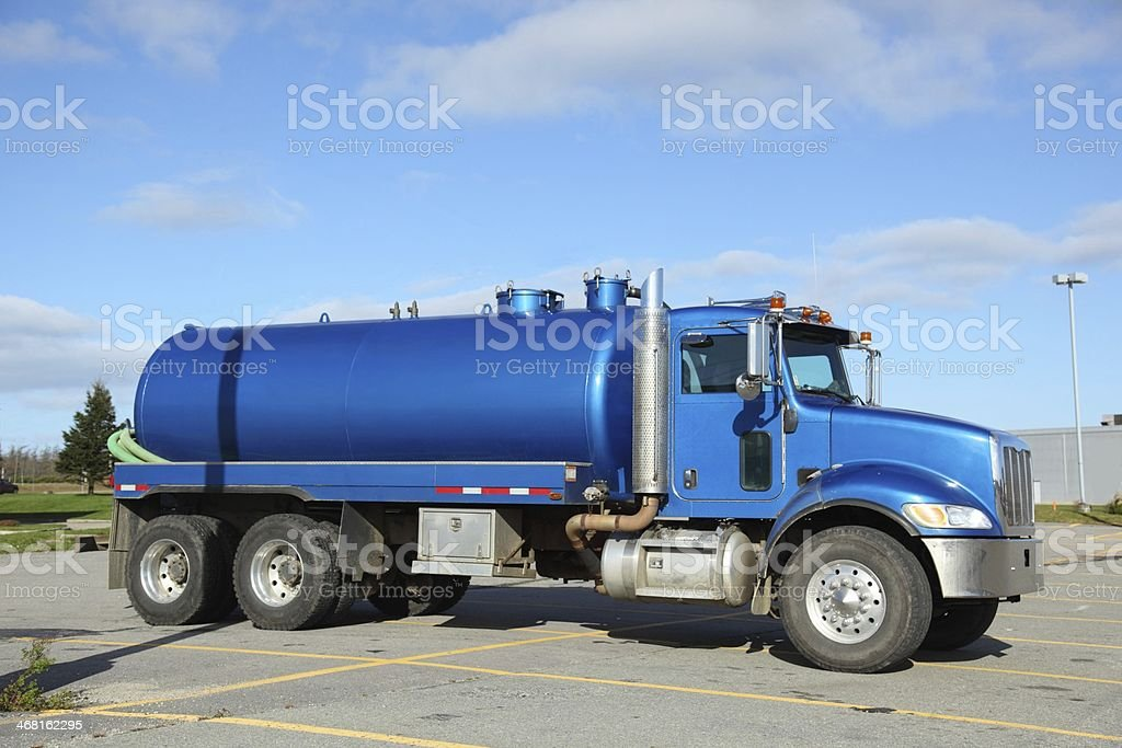 A blue pumper truck on a sunny day stock photo