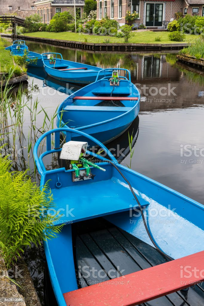 Blue Punter Boats Giethoorn stock photo