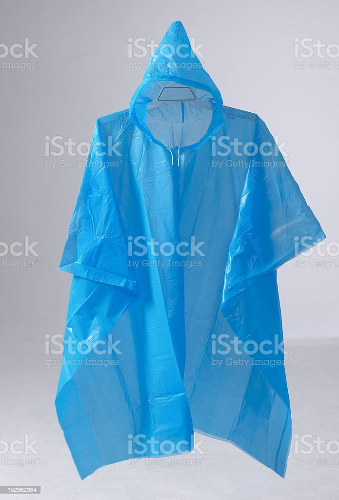 Blue rain poncho hanging stock photo