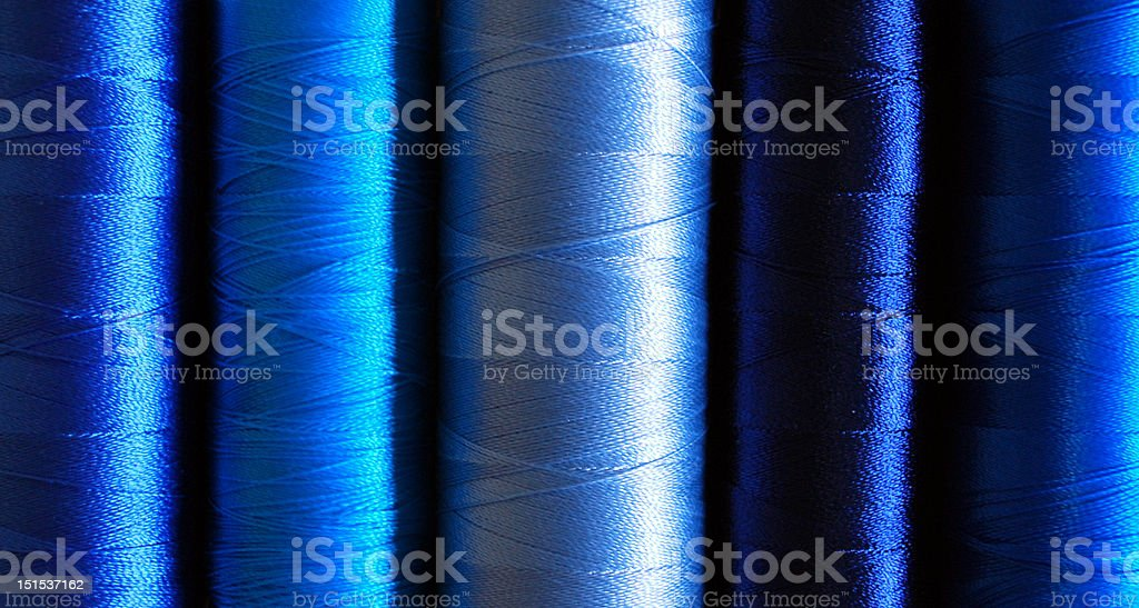 blue rayon embroidery threads stock photo