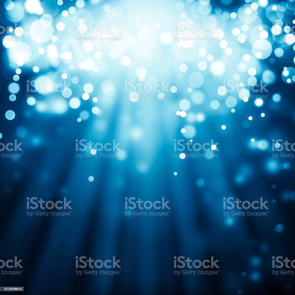 Blue rays of light with bubbles and glitters vector art illustration