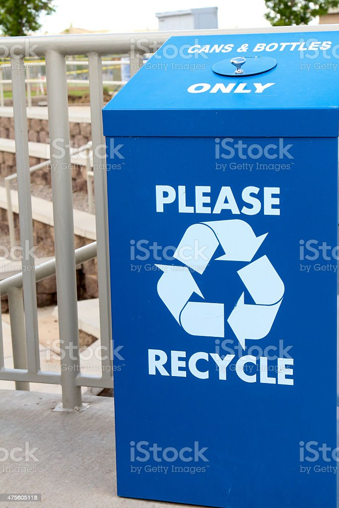 Blue recycling can for cans and bottles with symbol stock photo