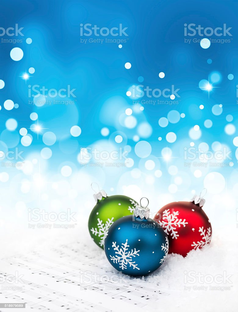 Blue red and green baubles on sheet notes stock photo