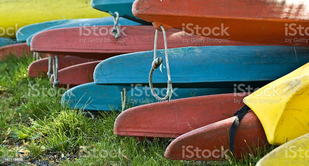 blue, red and yellow canoes royalty-free stock photo