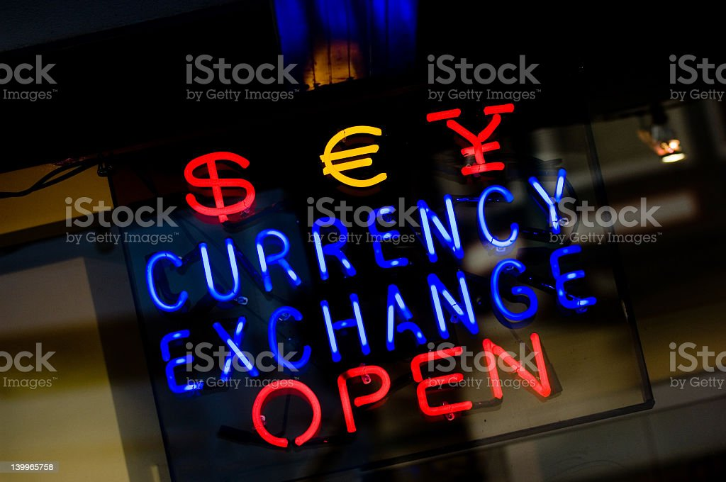 A blue, red and yellow currency exchange sign stock photo