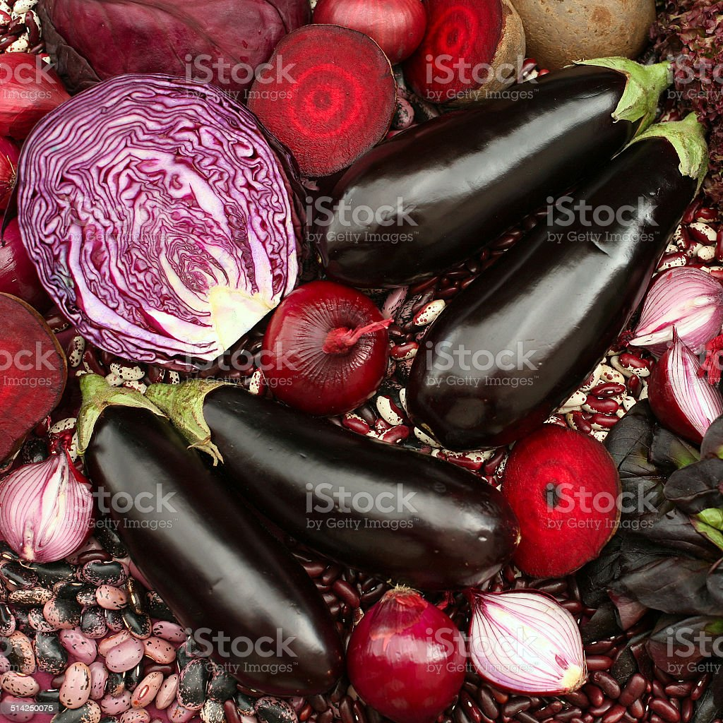 Blue red purple colored vegetables composition stock photo