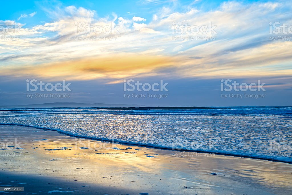 blue reflections and calm waves stock photo
