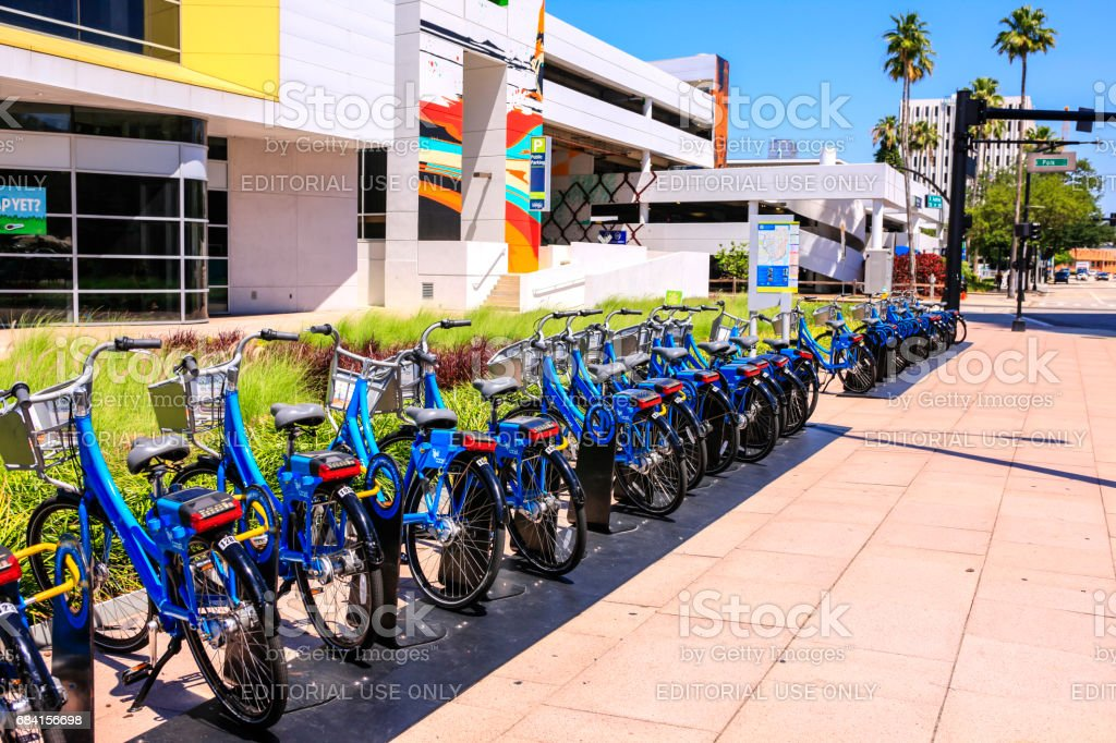 Blue Rental bicycles on the sidewalk in downtown Tampa Florida stock photo