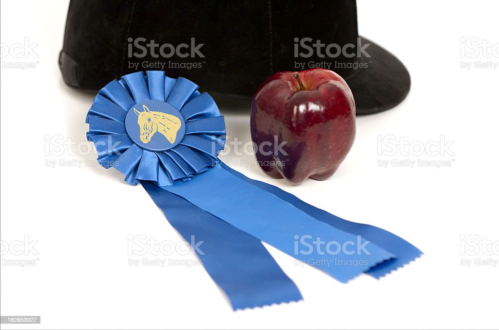 Blue Ribbon, Riding Helmet And An Apple royalty-free stock photo