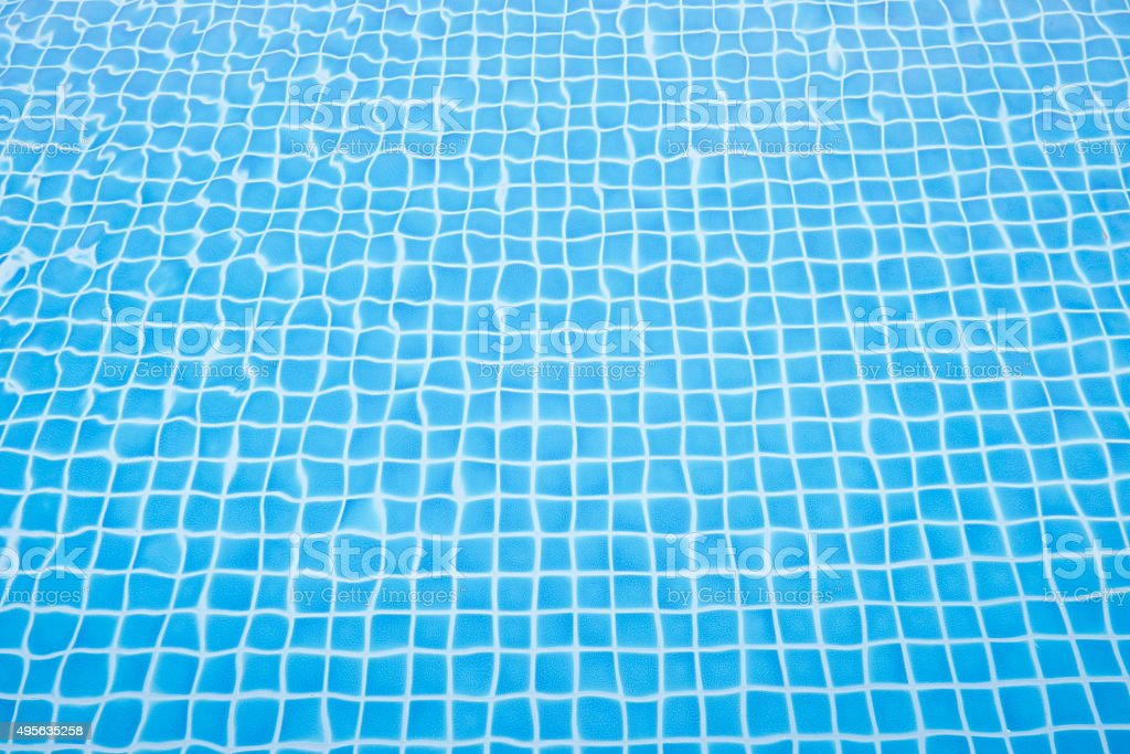 Blue ripped water in swimming pool stock photo