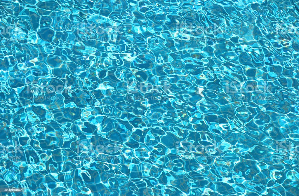 Blue ripple in swimming pool stock photo