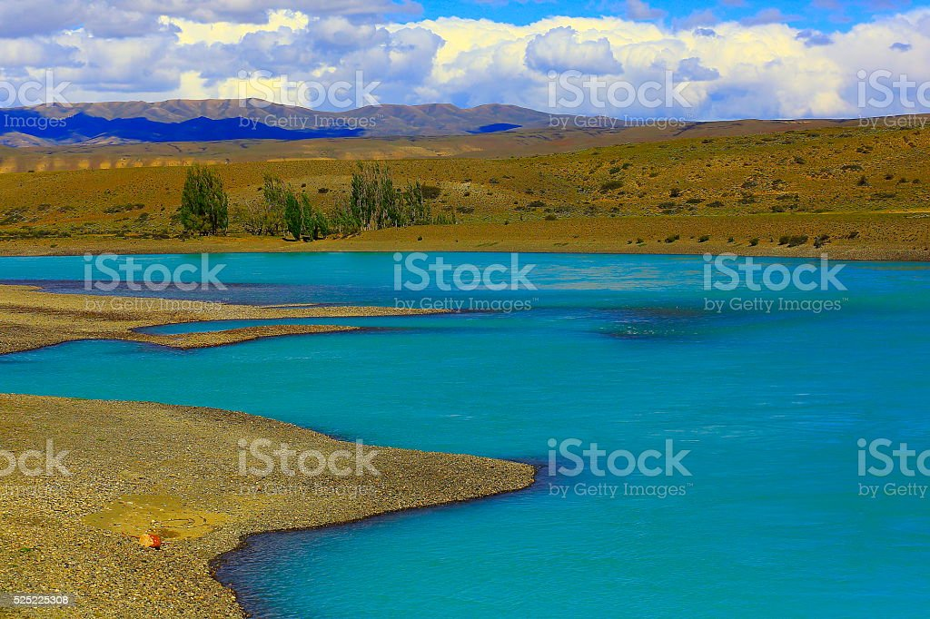 Blue river, Lake Argentina, meadow steppe, Patagonia, El Calafate stock photo