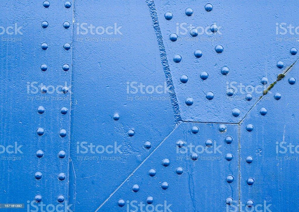 Blue Rivet Surface stock photo