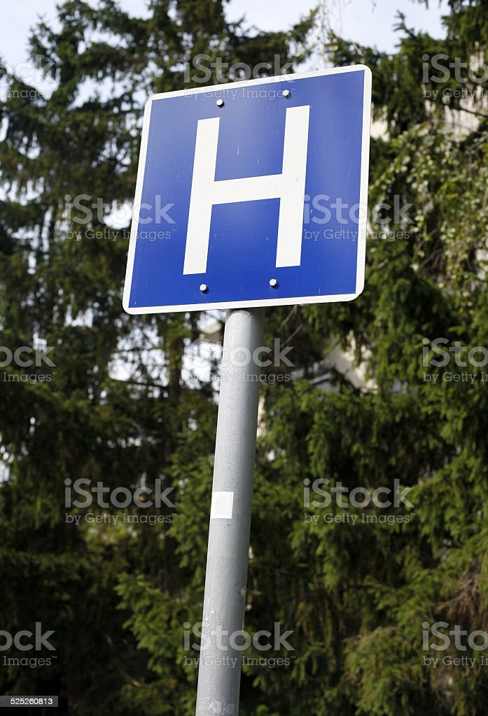 Blue road sign with a capital H stock photo