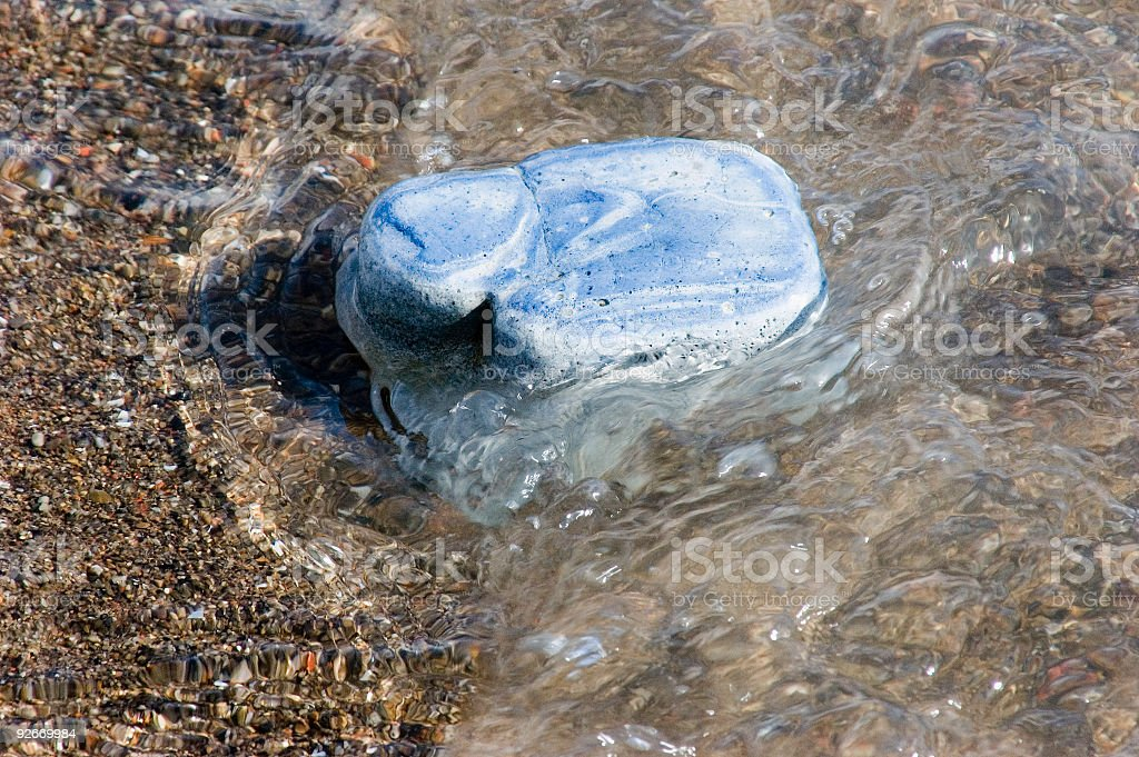 Blue Rock on beach and water. royalty-free stock photo