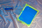 Blue rolling brush with green pallet