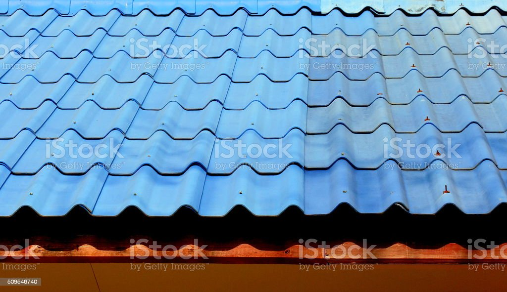 Blue roof tiles replace the damaged parts stock photo