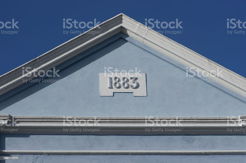 Blue rooftop against blue sky. House built in 1883, London, Europe. stock photo