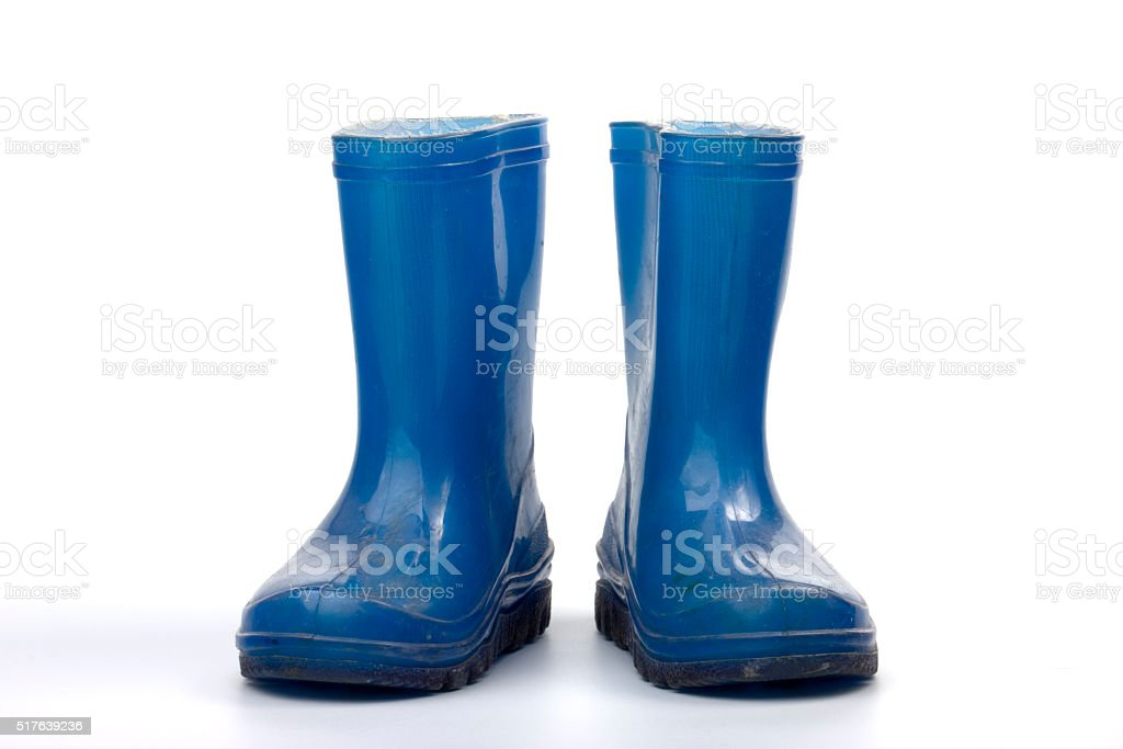 Blue rubber boots for child stock photo