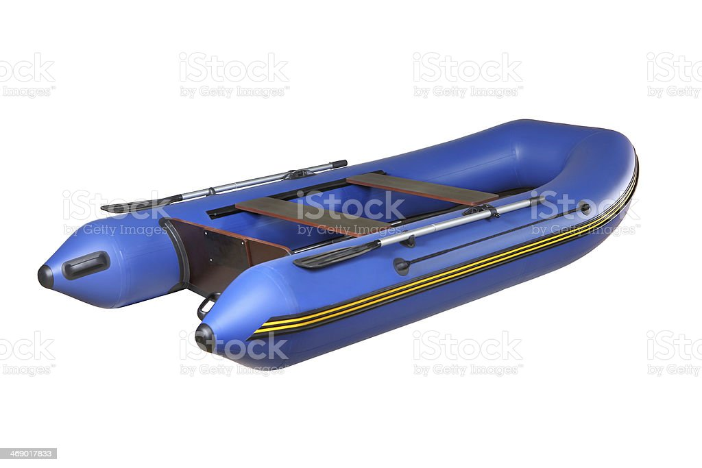Blue rubber inflatable boat PVC with oars, isolated on white. royalty-free stock photo