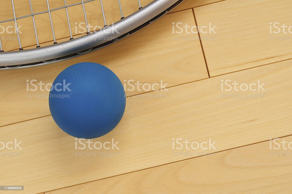 Blue Rubber Racquetball and Racquet royalty-free stock photo