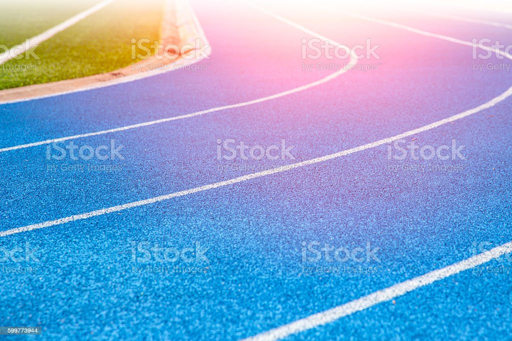 Blue Running track in Sport Stadium. stock photo