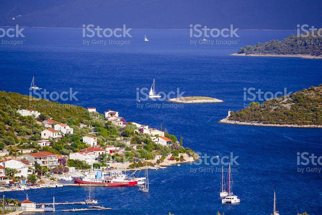 Blue sailing bay in Vinisce stock photo