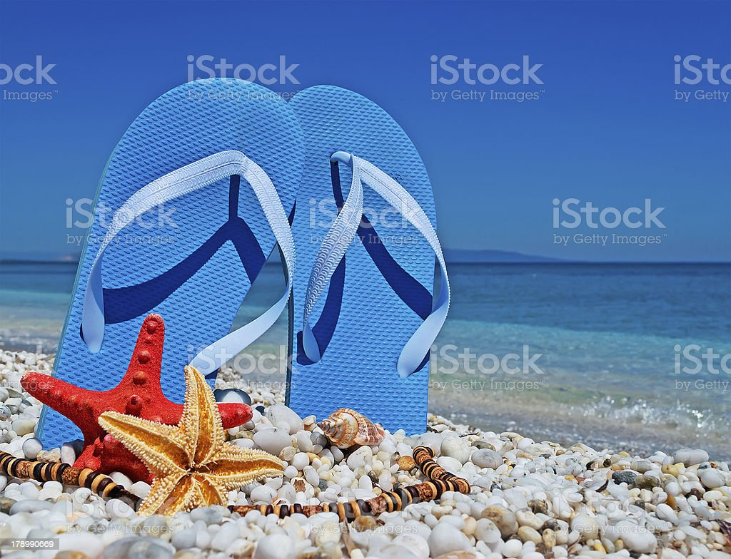 blue sandals on pebbles royalty-free stock photo