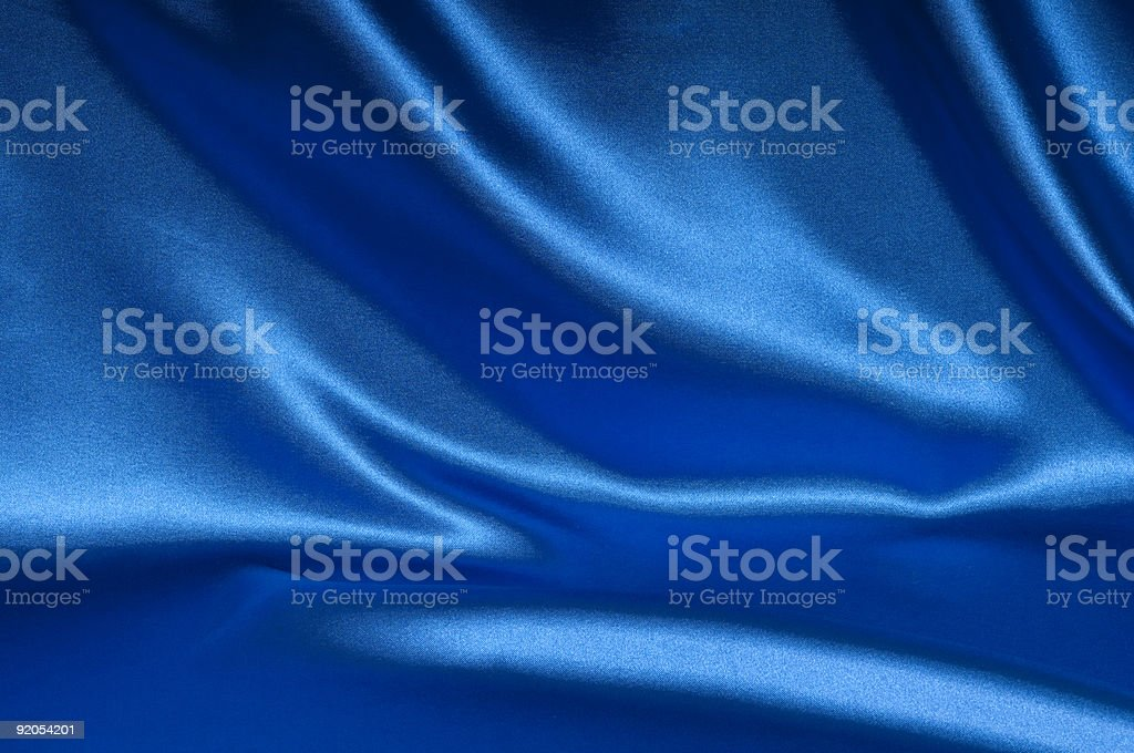 Blue satin fabric with creases background stock photo