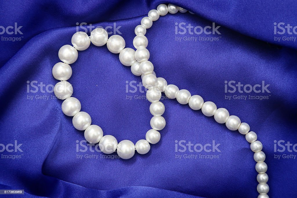 Blue satin with pearls stock photo