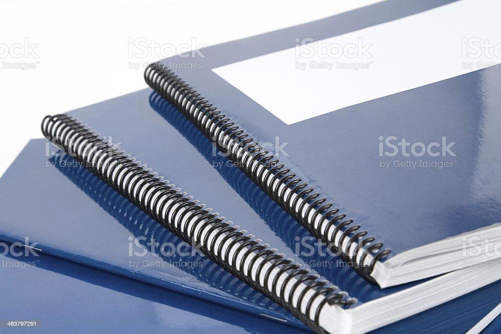Blue school notebooks and workbooks stock photo