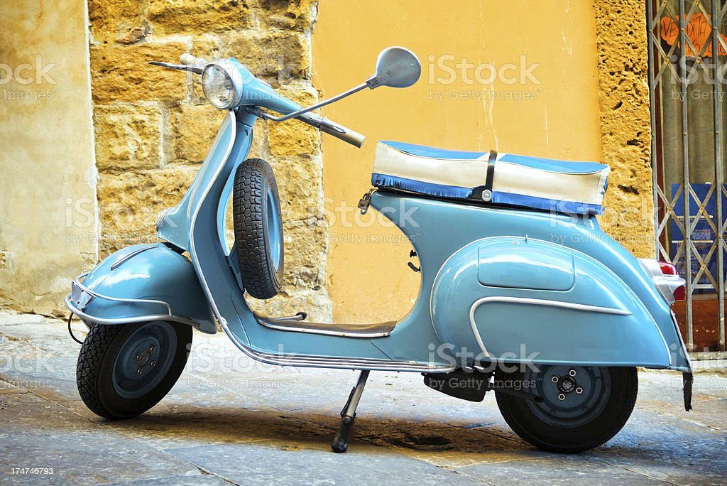 Blue scooter in Rome, Italy royalty-free stock photo