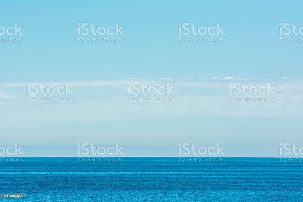 blue sea and clouds on sky stock photo