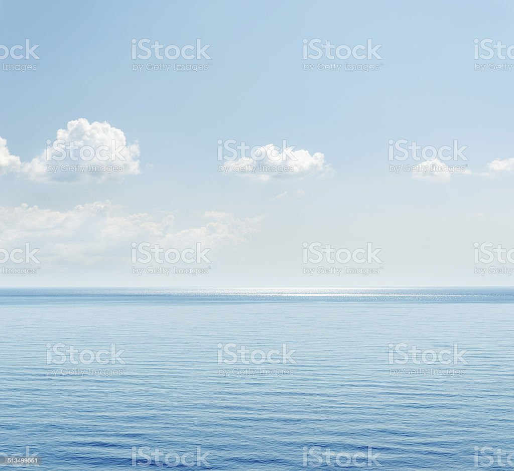 blue sea and clouds over it stock photo