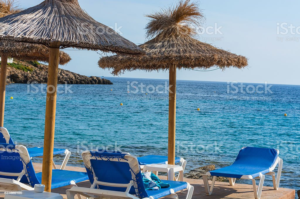 Blue sea, beach with umbrella on Mallorca. stock photo