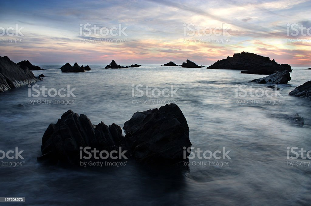 Blue sea during sunset in Devon England royalty-free stock photo