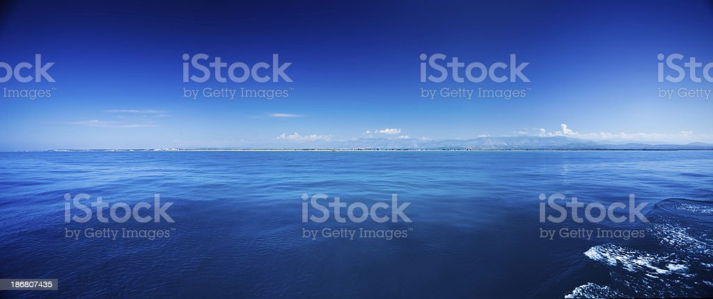 Blue sea over clear sky royalty-free stock photo