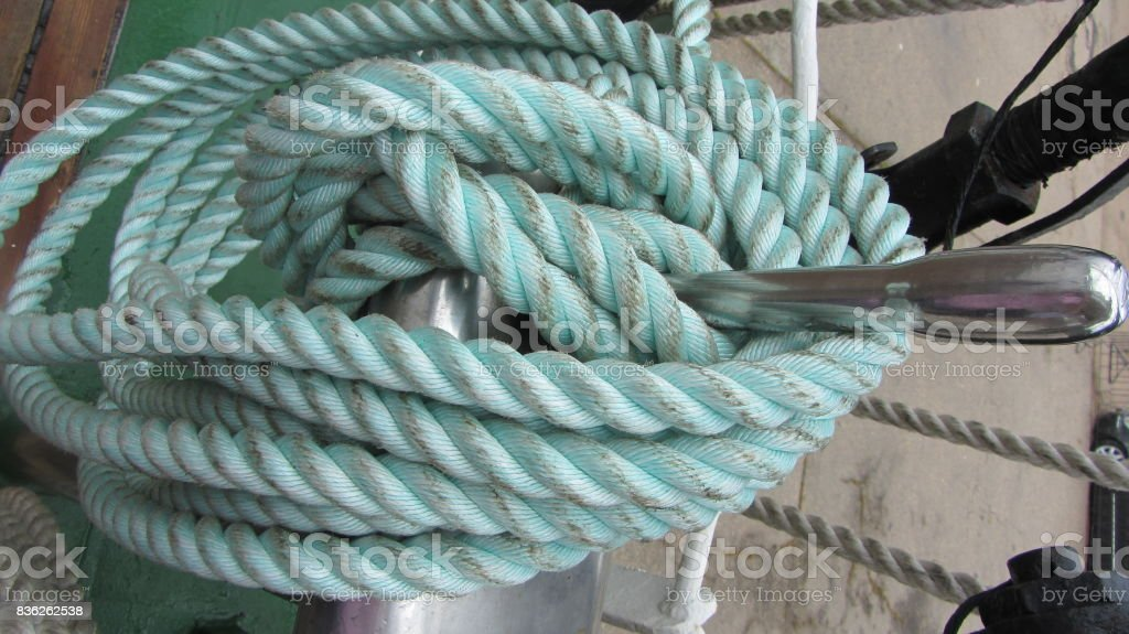 Blue sea rope on the ship deck stock photo